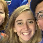 Gator football is a longtime tradition in the Pressly family. Herb Pressly (BCS '58), Scott's dad, took his kids to games when they were growing up, and now Scott is doing the same with his, pictured here with daughters Carden and KJ.